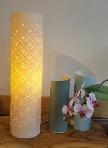 Two vases, blue porcelain slips white glazed interior. Lamp - large starburst.